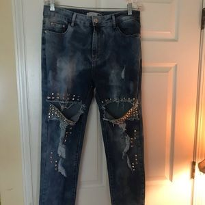 Studded distressed stone wash jeans